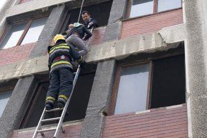 Fireman saving girl on the window