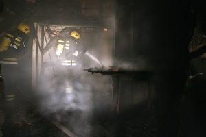 Fireman in burnt house