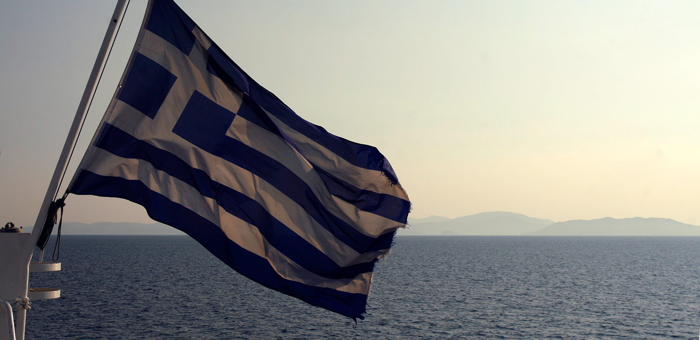 Greece flag with the view on seaside