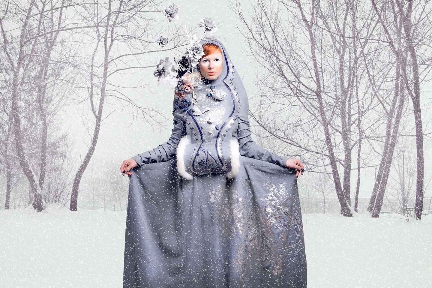 Readhead girl in fairytale costume in winter snow