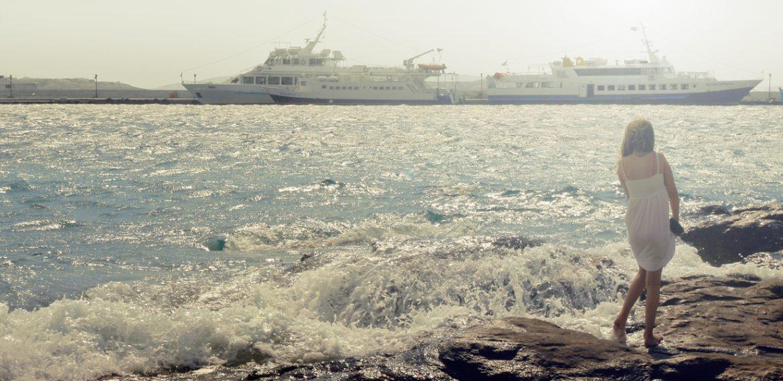 Mykonos seaside with litle girl
