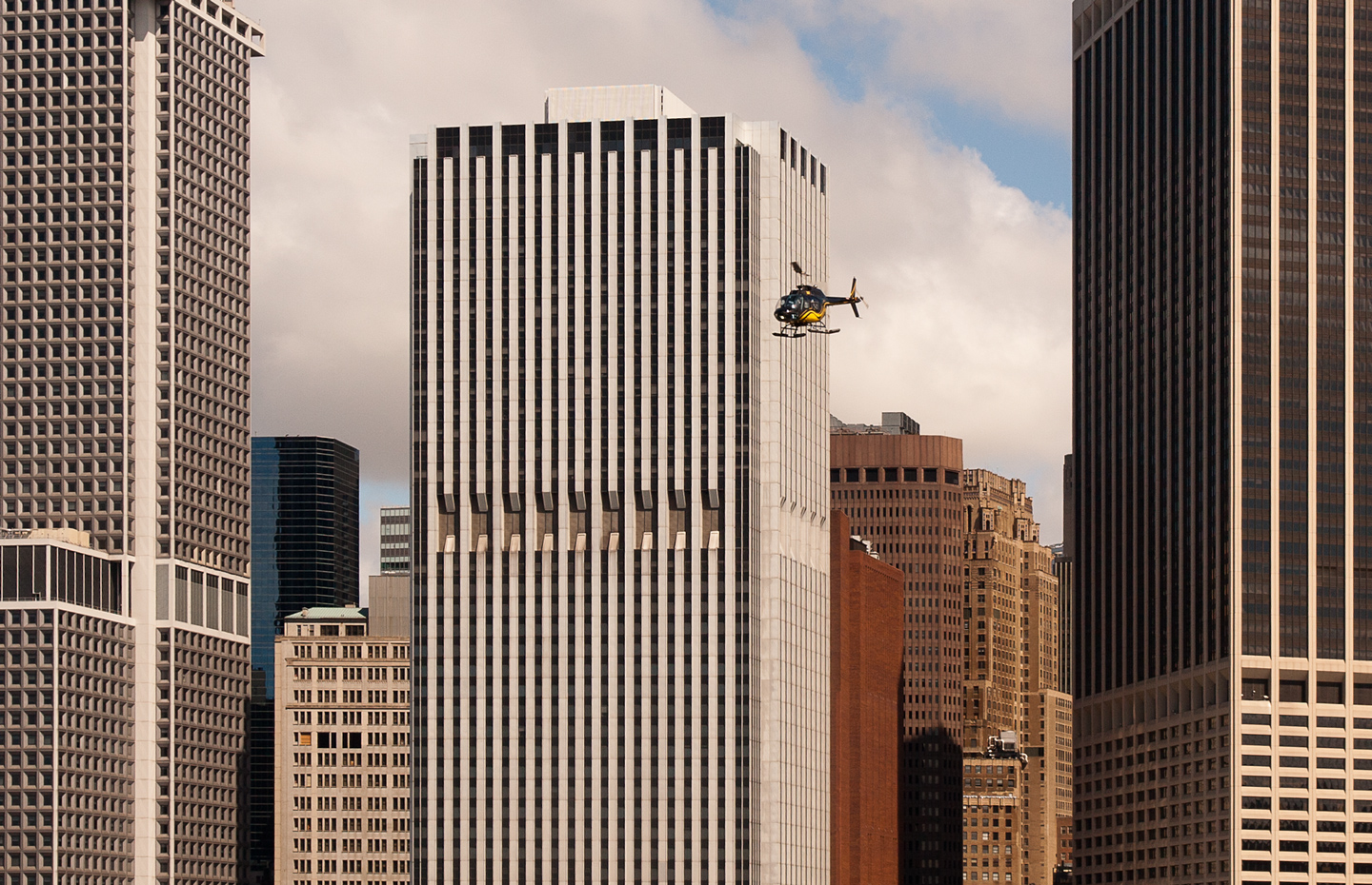 Skyscrapers with helicopter in Manhattan