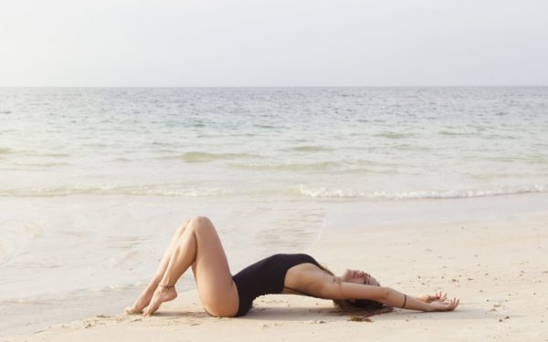 Girl laying on the beach on sand