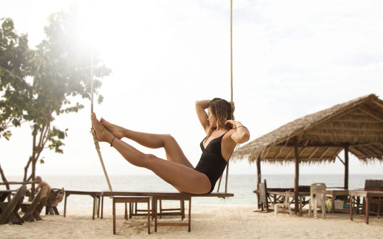 Girl_on_swing_in_beach_bar