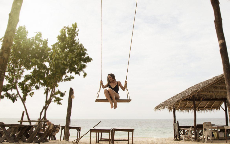 Girl_on_swing_in_beach_bar_on_sunset