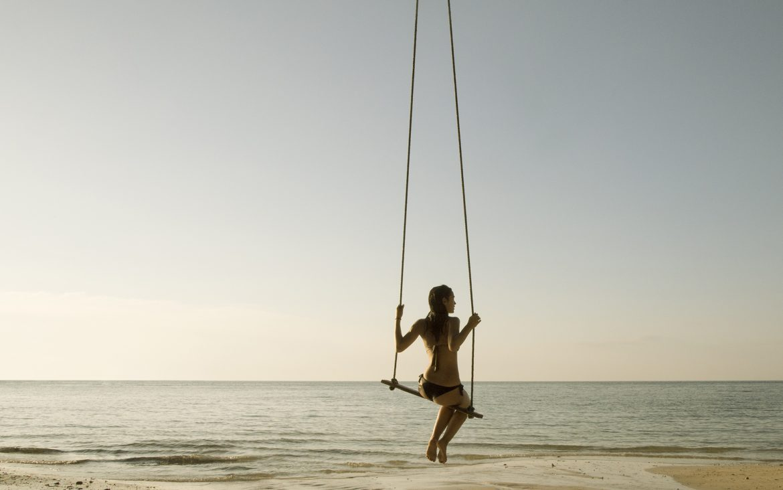 Girl_on_swing_on_beach