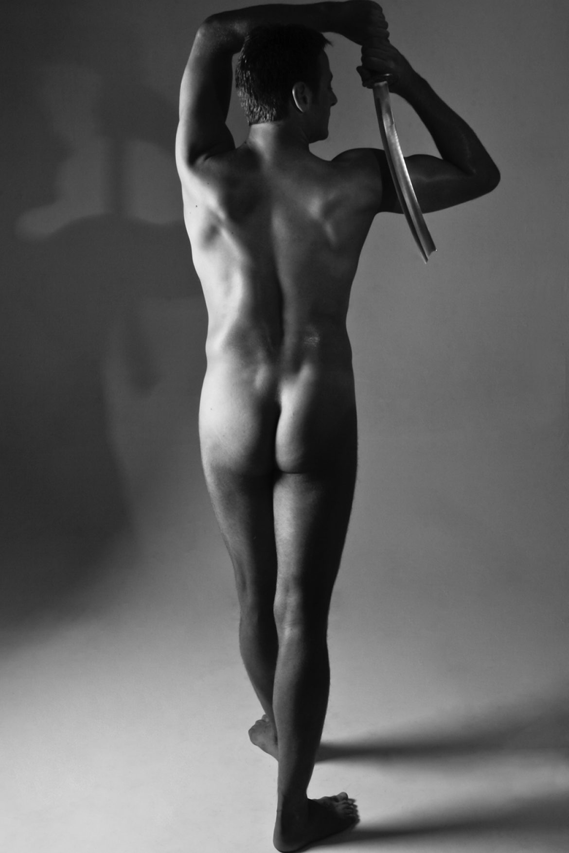 nude man with sword