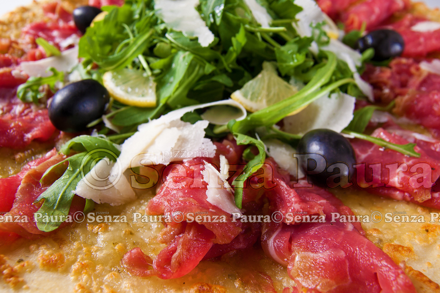 Raw meat tasty pizza with olives