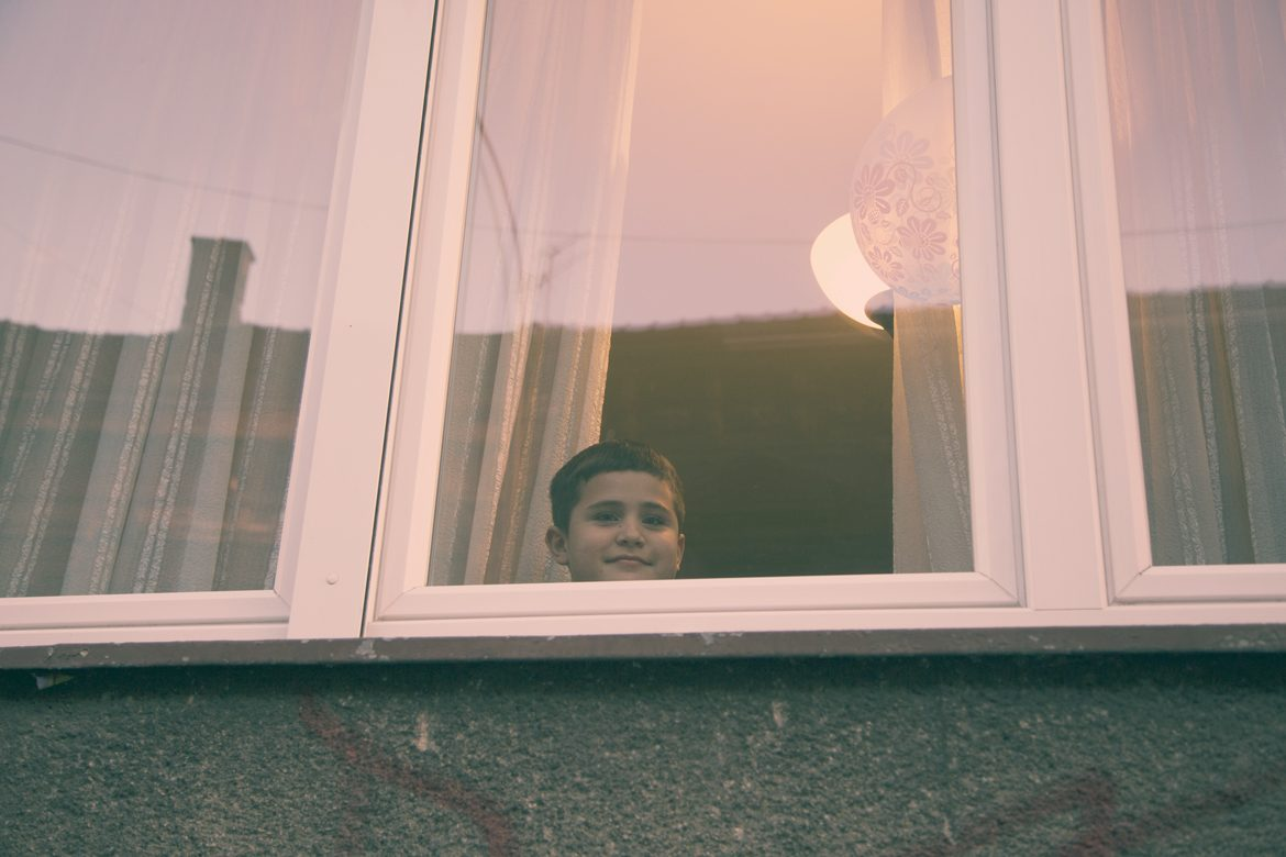 Protest kid behind window