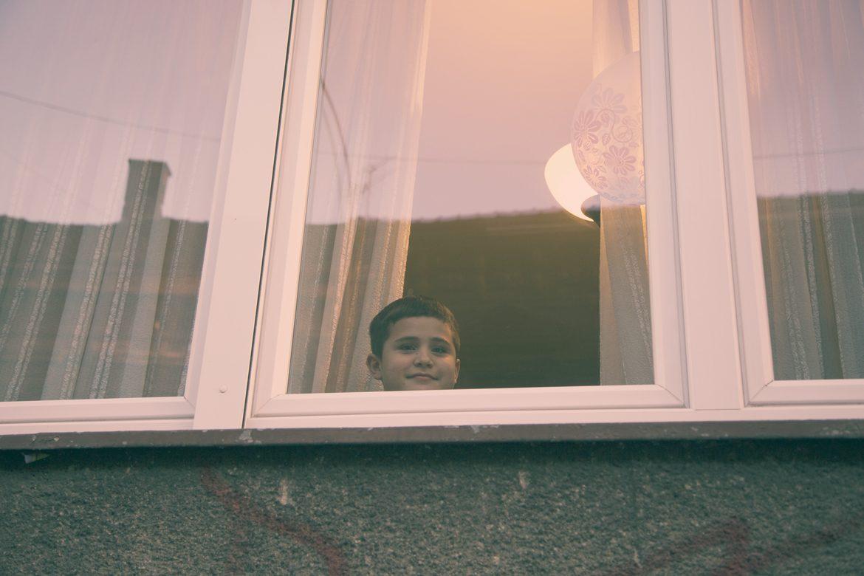 Protest kid behind window
