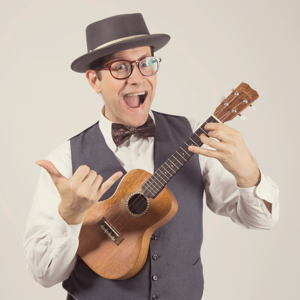 Guy holding ukulele instrument