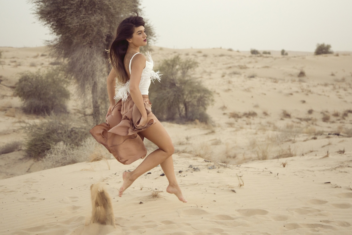 Girl jumping in Desert