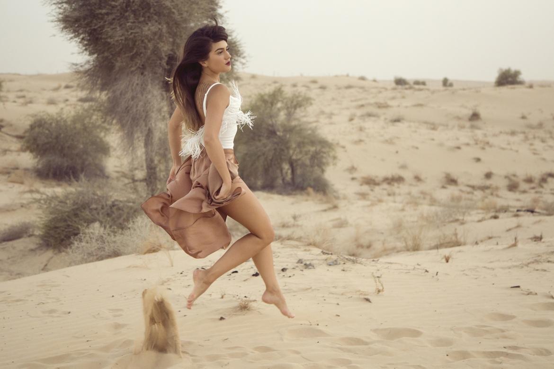 Girl jumping in Desert