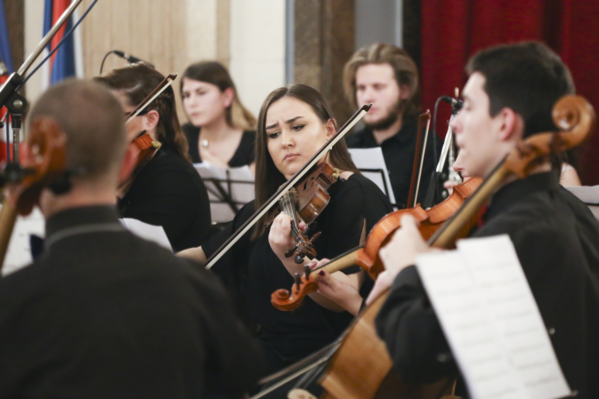 Young Violinist in Orchestra playing violin