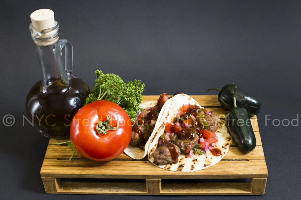Tacos with salad, meat, olive-oil and vegetables