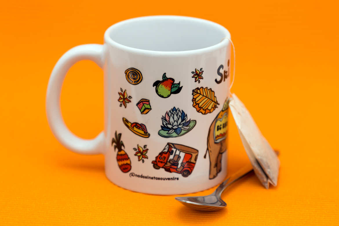 White Ceramic Tea Mug with colorful Illustrations