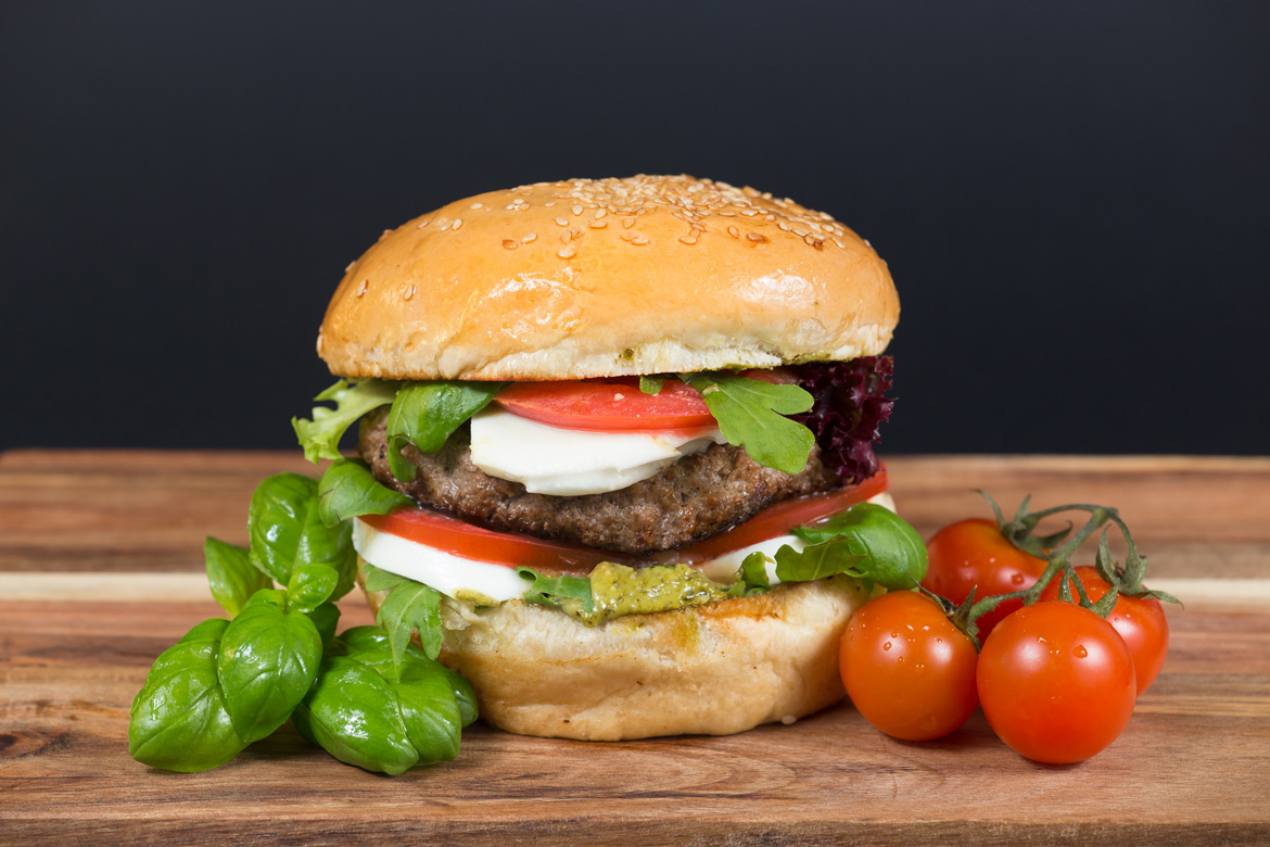 Burger with tomato, salad, cheese and meat