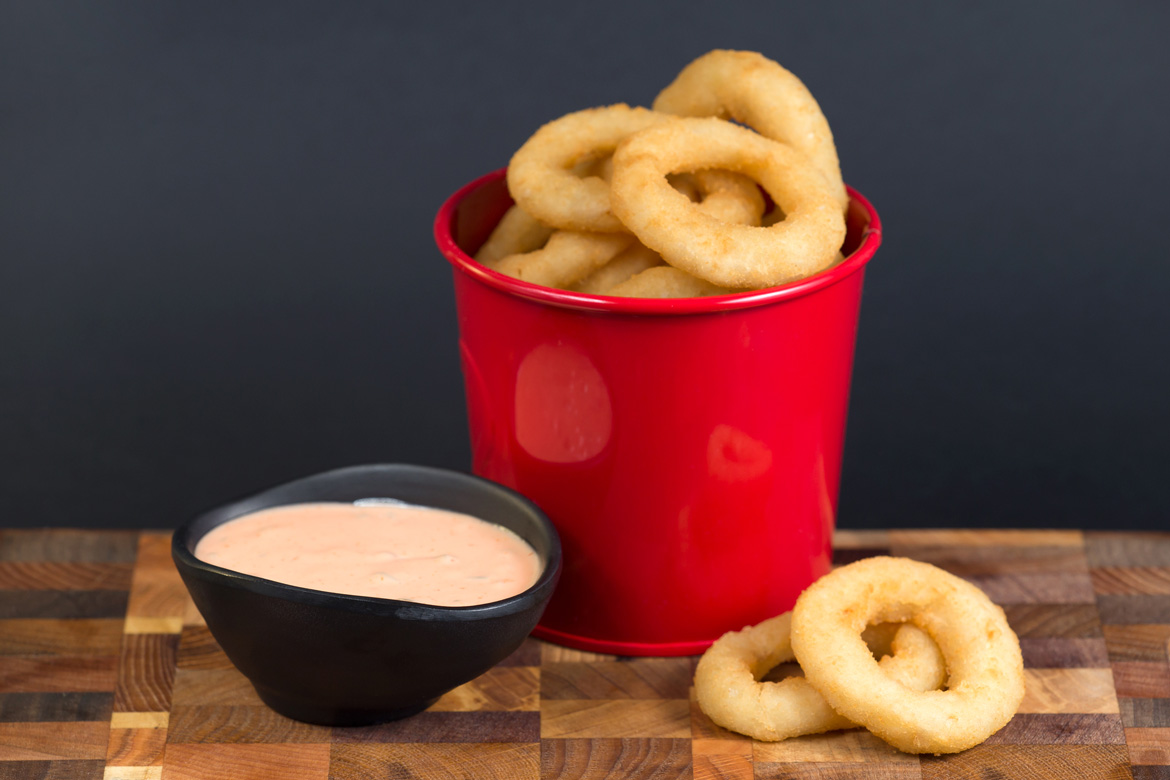 Onion rings in red dish